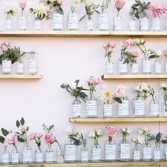Pretty smitten with this flower wall!  (Photo by @braedonflynn as featured on @greylikes)