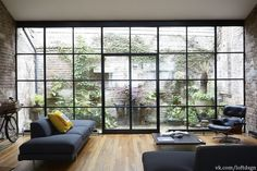 Industrial Design Homes Window - the industrial design for homes room is mostly filled with windows that lead directly to the outside plants that decorate the house.