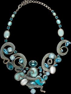 "Aquatic Bib Necklace    The Aquatic Bib Necklace mixes the softness of light blue Swarovski crystals and an antique silver chain with the boldness of winding rhinestone chain. It makes a shimmering statement whether you're making an entrance at your next event or taking time to yourself to relax and feel beautiful.    Item NumberNSP2ASAQU width 5¼"" length 15½""  $1032.70"