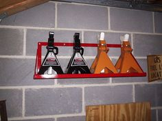 Jack Stand Storage by welder4956 -- Homemade wall-mounted jack stand storage fabricated from flat bar stock and angle iron. http://www.homemadetools.net/homemade-jack-stand-storage