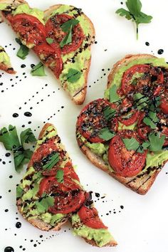 Simple, easy and delicious - Roasted Tomato Avocado Toast. Creamy Avocado mash, sweet roasted tomatoes, drizzled with balsamic glaze, it takes toast to a whole new level. | potluck at ohmyveggies.com