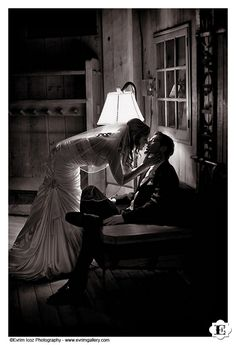 Artistic shot of the bride and groom kissing inside Timberline Lodge