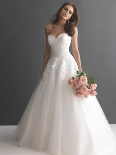 This romantic ball gown is created from soft, lace applique and English net.  The strapless, sweetheart bodice is adorned with lace with a fitted dropped waistline.  From Allure Bridal.