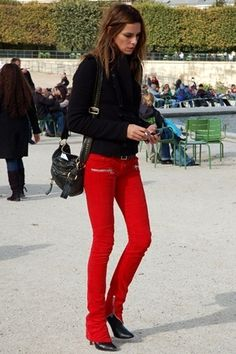 Red skinny and black top.