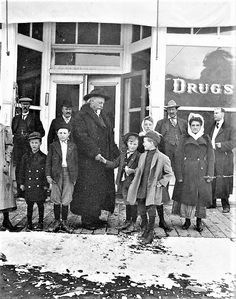 William F. Cody shakes hands with a young boy on the board walk in front of the drugstore in Meeteetse, WY. The photo is archived at the Buffalo Bill Center of the West http://cdm17097.contentdm.oclc.org/…/coll…/BBOA/id/824/rec/1