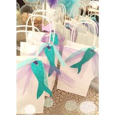 Description Our Mermaid favor bags are so magical! Give your guest something they will remember forever. These favor bags will definitely make your party one of a kind. • DESCRIPTION • - - - - - - - - - - - You will receive 12 paper bags. Bag dimensions: 8 Tall (12 with handles) /
