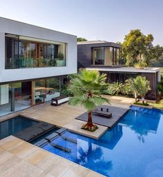 This Home Was Designed To Wrap Around The Swimming Pool