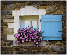 Cottage window with French-blue shutter...