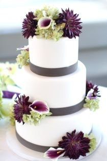 Wedding cake with grey ribbon + flowers