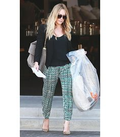 Hilary Duff  We love this simple yet ultra flattering look, courtesy of Duff. Her solid black top and cardigan complement her printed Parker Abbey Silk Pants ($90) for a well-balanced ensemble. If you're up for the challenge, try a pair of nude pumps like Duff for a polished look.