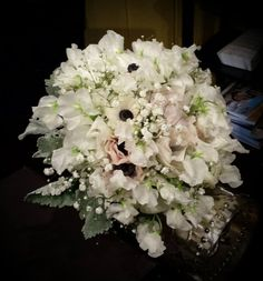 Zuzu's Petals Events: Light and airy bouquet of babies breath, white anemones, and white sweet peas.