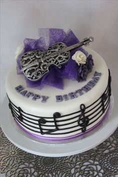 a violin cake with music notes made from modeling chocolate - by Cake Occasion