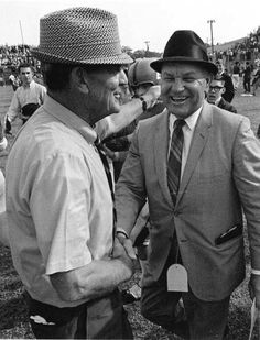 Alabama coach Bear Bryant and Ole Miss coach Johnny Vaught meeting on the field in Jackson, Mississippi in 1970. Ole Miss beat Alabama that day, 48 to 23.