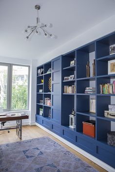 Home office with blue furniture in Bucharest