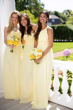 Bridesmaids looking lovely in long lemon dresses by Donna Morgan