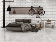 Modern loft style bedroom in apartment with furnishings, round bed, and bicycle hanging on wall. Notes: A general design for a loft or small apartment bedroom. Loft Style Bedroom, Style Loft, Flooring Store, Commercial Flooring, Modern Loft, Floor Decor, Floor Lamp, Kitchen On A Budget, How To Clean Carpet