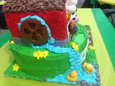 Barn cake with farm animals made with fondant and buttercream.
