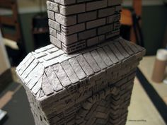 A recap of the Heritage chimney from inspiration to 1:12 scale reality!  :D  The original W E Masonry chimney as inspiration And the process from start to finish with a foam core, wood and cardboard base topped with egg carton brickwork.…