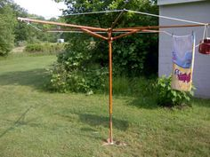 Don't throw away that old patio umbrella! Re-purpose it as a clothesline!