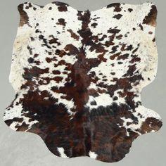 Reddish Brown Tricolor Cowhide Rug. cowhidesinternational.com