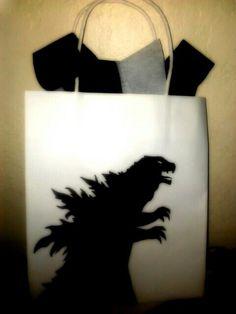 Diy Godzilla gift bag.. all i used was white gift bag and black shape!