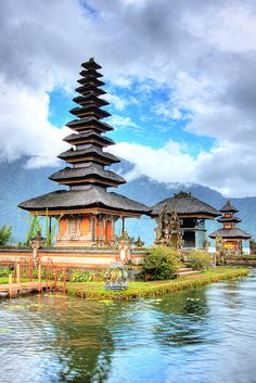 "This is one of Bali's most important temples - the temple of Ulun Danu. The pagoda-like structure is known as ""Meru"". This temple's meru has 11 tiers which is the highest number of tiers possible for a Balinese Temple. This signifies the importance of its deity. The dark fibre used for the roof, which resembles human hair, is a product of the sugar palm.  If you'd like to see the rest of my Bali photo collection, please click here."