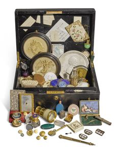 A Large collection of objects of vertu, various makers and dates including a gilt-metal and mother of pearl carnet, French, circa 1818, 8.7cm, 3 3/8 in. high; a shell snuff box with silver-mounts, 19th century, 8.5cm., 3 3/8 in. wide; a 18ct gold calendar pen, Thornhill & Co, with presentation inscription and date 1928, opened: 14cm., 5 1/2. in long, a gold-mounted walnut sewing necessaire, with ivory thimble and other miniature implements, circa 1900, 4.5cm., 1 3/4 in. wide;