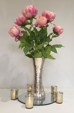 Large pink peonies in a gold crackle vase centrepiece with accompanying champagne gold tea lights #piecesandposies