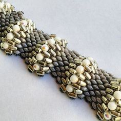 """Our new """"San Andreas"""" bracelet design, which uses peyote stitch with two-hole Superduo, Rulla, and RounDuo beads to create the ripple effect. Get all of those beads on Potomac Bead Company's website: http://www.potomacbeads.com/Seed-Beads-s/2128.htm"""