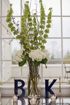 Could put A and J at guest book table. White Green and Navy Wedding Preppy Virginia Country Club Wedding Reception: Katharine + Brad Wedding Flower Arrangements, Flower Centerpieces, Wedding Centerpieces, Wedding Flowers, Wedding Decorations, White Centerpiece, Decor Wedding, Table Arrangements, Floral Arrangement