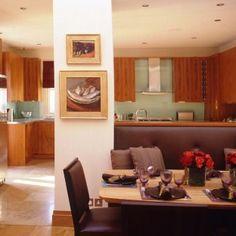 Teak veneer  kitchen with glass worktops designed by Candi Kitchens