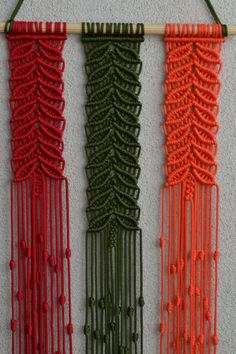 Wall panels handmade macrame technique. Material: 100% polyester. Color: olive, orange, rotten cherry. Strap: natural wood - pine. Dimensions: Length of a wooden stick 39cm The length of the middle spit from the wooden stick to the bottom 82cm