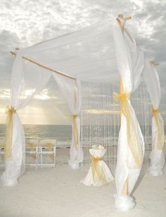 Florida beach wedding style by Suncoast Weddings .... gold sashes and a crystal garland to celebrate in style