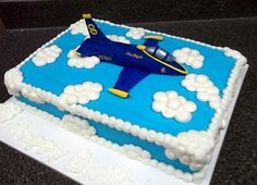 Blue Angels cake for a little boy turning 8. His birthday was on May 24th and because of the tornado in our area(Joplin) they are just now having his party and instead of gifts he is collecting donations for the family of a little girl in his class who was killed along with her father. The plane is fondant and the sky buttercream