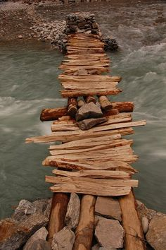 With twigs and rocks, we bridge the gap (Bridge in Nepal). Nepal, Scary Bridges, Ouvrages D'art, Over The Bridge, Les Religions, Covered Bridges, Pathways, Stairways, Wonders Of The World