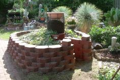Keyhole Gardens.  I would love to try this design.  Pretty and practical, my favorite combination.