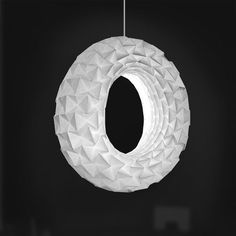 Torus Folded Lamp by Jiangmei Wu—Folded from a single sheet of 100% recycled cotton paper, with illumination by LED strip.