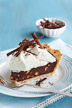 Macadamia nuts, chocolate, and espresso combine to make the filling of this decadent and delicious toasted coconut crust pie.