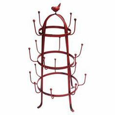"""Red metal drying rack with a bird finial.  Product: Drying rackConstruction Material: MetalColor: RedFeatures: Bird finialDimensions: 23"""" H x 12.5"""" Diameter"""