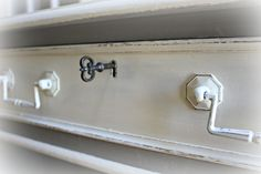 The vintage style key locks to top three drawers of the desk.