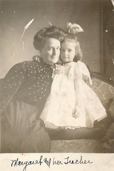 A little girl with her teacher.