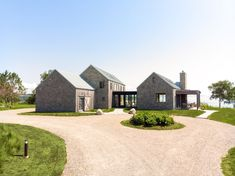 House exterior - Photo 2 of 12 in One Couple's Contemporary Coastal Retreat Celebrates… – House exterior Modern Barn House, Casa Patio, Modern Farmhouse Exterior, House In The Woods, Exterior Design, Exterior Siding, Exterior Colors, Building A House, Building Ideas