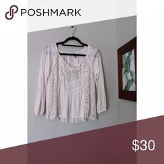 Cream long sleeve top with sheer detail Cream long sleeve top with sheer detail. Fits great on all body shapes, can fit medium and large. Never worn, tags still on. Perfect for all seasons. American Eagle Outfitters Tops Blouses