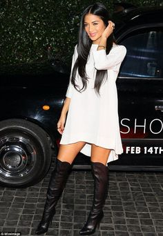 Nicole Scherzinger white elbow-sleeved high-low dress and black leather boots (at the Topshop launch party in West Hollywood on February 13, 2013)