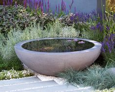 Water feature pond bowl from Urbis with dry gravel planting by Rae Wilkinson, garden built by Living Landscapes