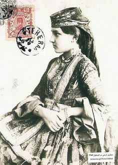 Postcard from the Qajar era showing an Armenian girl from New Julfa, Isfahan. Part of her head-piece is called benaris, which was a rare handcrafted tashkinak (handkerchief) from India. The pearls around her neck are called Bozhozh, which used to be a wedding gift from the in-laws.