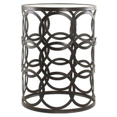 Simplicity and elegance combine in this contemporary and stylish barrel table, complete with an oil rubbed bronze finish, interlaced circle accents and an airy design.