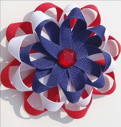 Fourth of July rosette hair clip. Ok girls let me know if I should make these, I think matching sundresses would be cute too. Lu