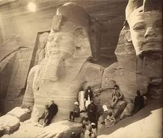 A rare early photo of statues before Europeans shot the noses off.