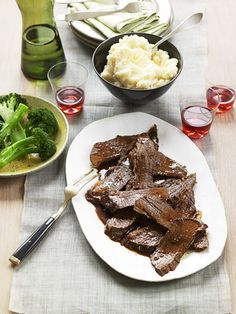 Beef brisket. Looks yummy for Christmas Eve dinner.